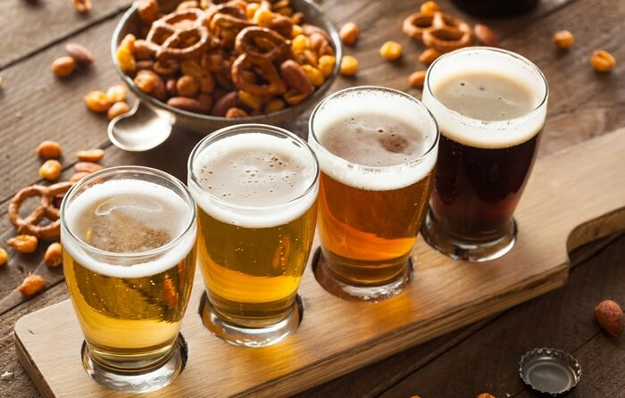 Picture of sample with 4 glasses of craft beers of Costa Rica