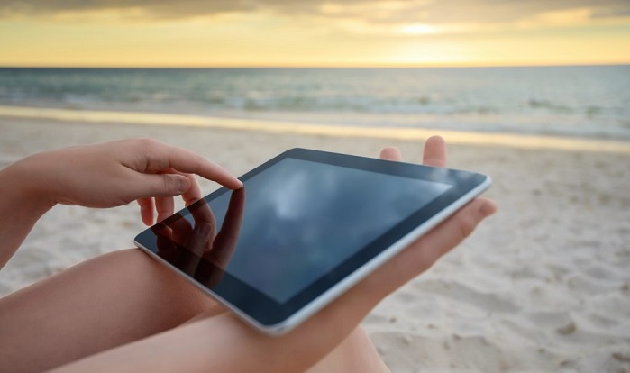 Woman using a tablet on Costa Rica beach